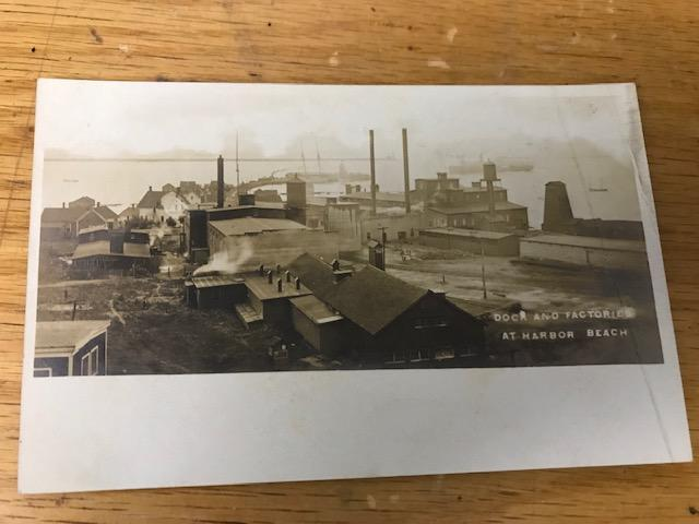 "Real photo postcard ""Dock and Factories At Harbor Beach"""