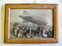 1930 LZ 127 framed presentation photo of a Zepplin landing. With reverse having a statement from the General Director (probably of the Zepplin Co.) with his stamped signature giving thanks to the people who helped make sure the landing was successful. A